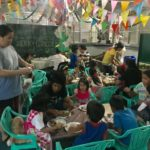 Orphans make crafts in a room in the Philippines